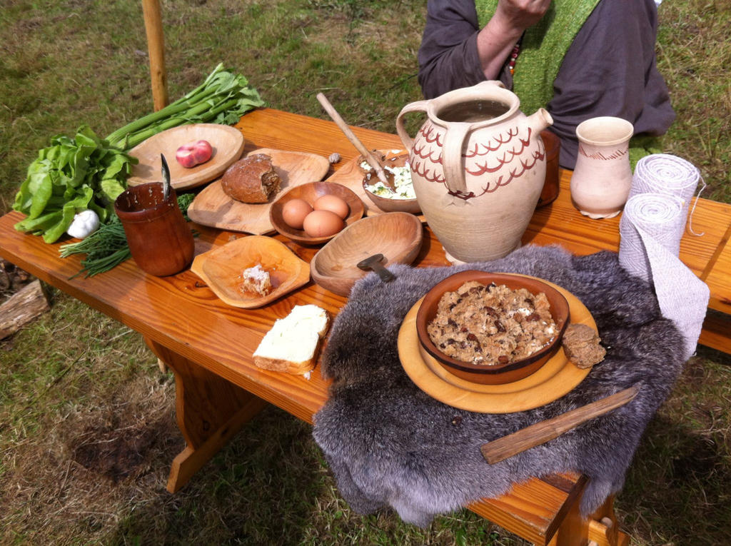 Medieval table with food by Dewfooter