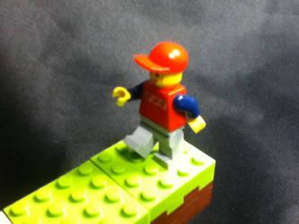 Lego man walking on Minecraft blocks by SuperYoshiCookie