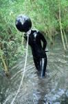 Rubber slave in the jungle