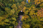 Aerial view of waterfall in Indonesian tropical by rahmadhimawan