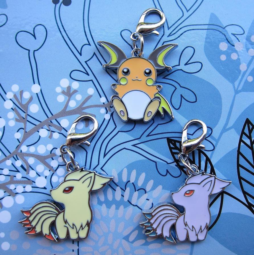 December Charms: Raichu + Ninetales by winter-wish