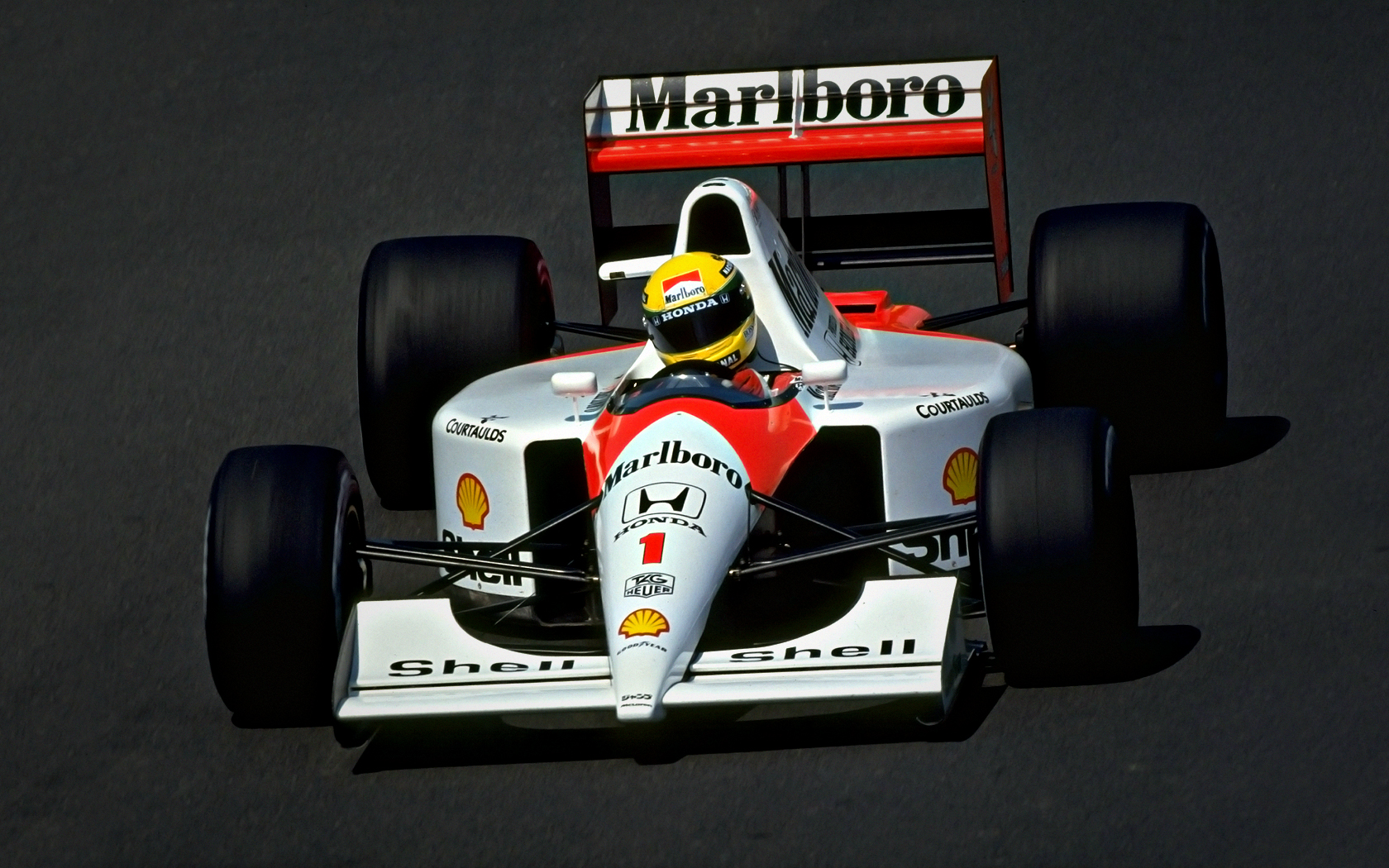 ayrton_senna_wallpaper_mclaren_by_johnny