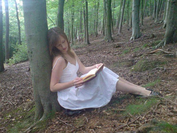 Girl reading book side view by EmKins-Resources