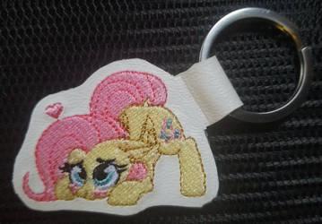 Playful Fluttershy keychain tag