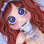 Doll with a cup of tea