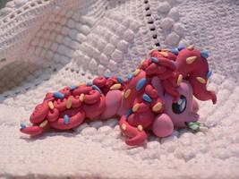 Pinkie under sugar coating by Flattersora12