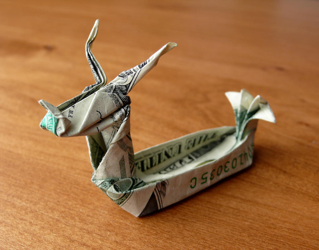 Origami shape boat made from US dollar bill, grey background Stock ... | 801x1024
