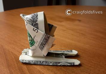 Dollar Origami Santa Skiing by craigfoldsfives