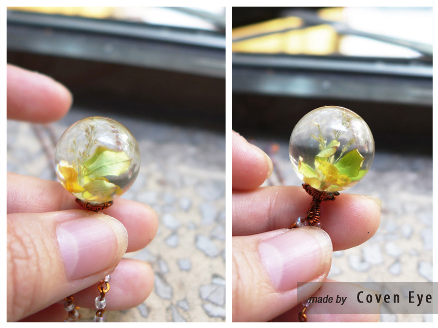 Resin ball pendant with leaves by CovenEye