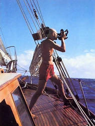 sailor with sextant on sailboat