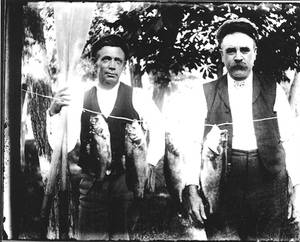 Two fisherman and catch from glass plate negative