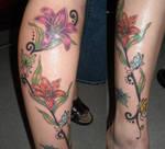 freehand swirly lily tattoo