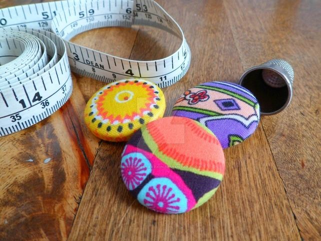 Recycled fabric buttons by hmwillustration