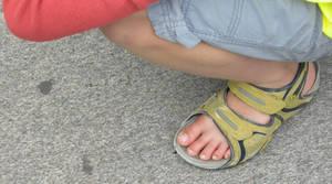 Giant guys foot in sandals