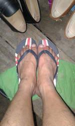 My friend like his flip flops. by Tinybr