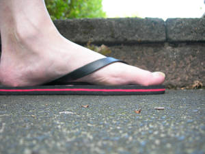 A giant foot in flip flop in the garden