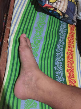 A side view of his foot