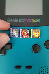 Miniature Pokemon gameboy game boxes by EmisBakery