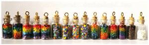 15 rainbow bottles, sitting...