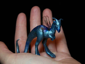 Shy tiny little dragon