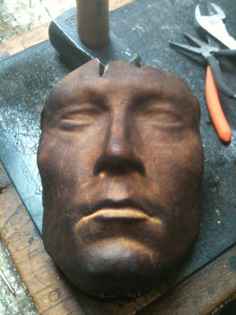 Leather mask of a bust.