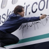 why yes he is signing a plane by onewithmonkey