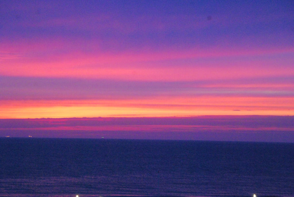Colored Sky  in Zandvoort, the Netherlands by alain-angela
