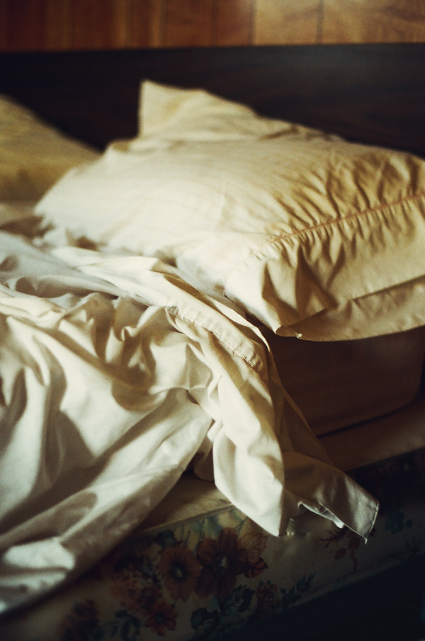 an empty bed in an empty room by aimeelikestotakepics