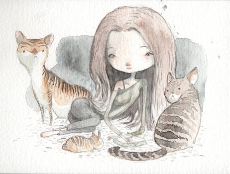 surrounded by cats
