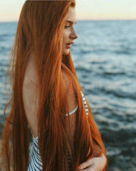 Redhead and the sea by Davium99