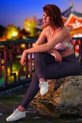 Gina sitting on a rock