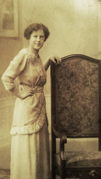 Lady in white with chair