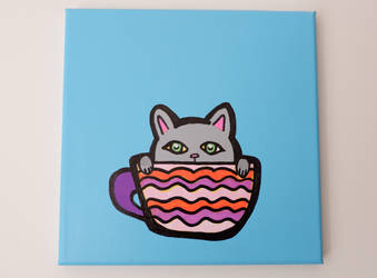 grey cat in a cup