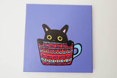 black cat in a cup