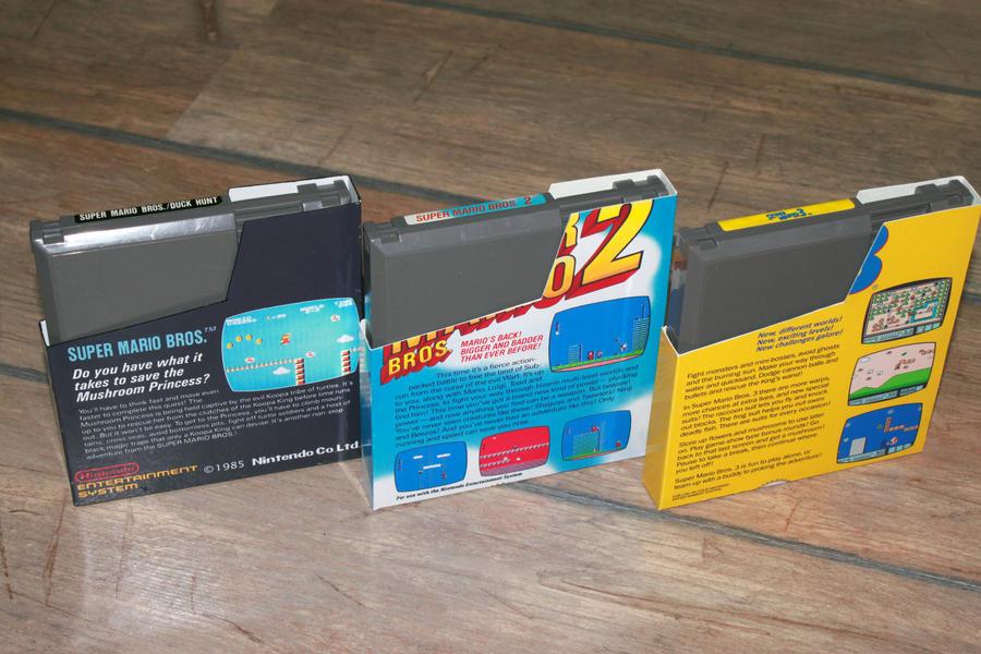 Nintendo 8-bit Super Mario games dustcovers BACK. by Jaki33