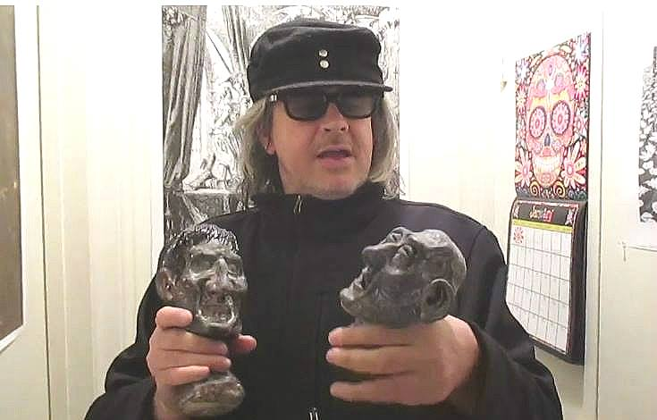 Me holding 'Auchwitz Babies' doll heads by Germanicus-Fink