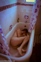 depressed male nude in bath 2 by TheMaleNudeStock