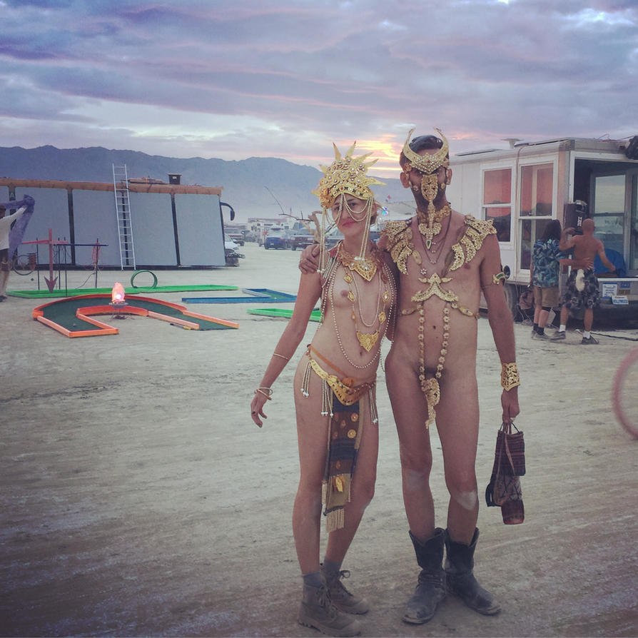 straight couple in gold at burning man  3 by TheMaleNudeStock