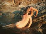 merman stock nude men kissing in the surf 1