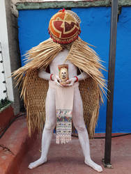 prehispanic man rain cape and offering