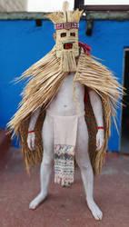 standing front mexica regalia man rain cape