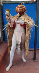 standing Mexica man with offering, side