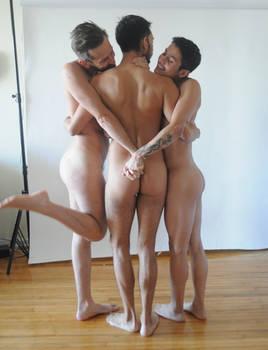 3 nude men embracing