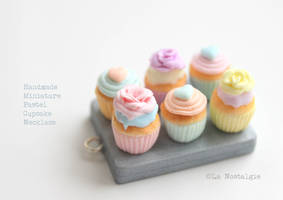 Miniature Pastel Cupcakes with beautiful frostings by LaNostalgie05