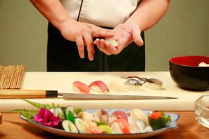 Chef Prepping Sushi by 123rfanna