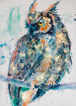 Great horned owl in gold