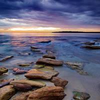 Low swell on a rocky coast by Kounelli1