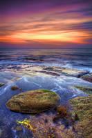 Waves flowing off mossy rocks by Kounelli1