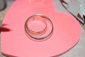 Our rings... by Indianwhitespirit
