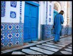 Man walks past masjid